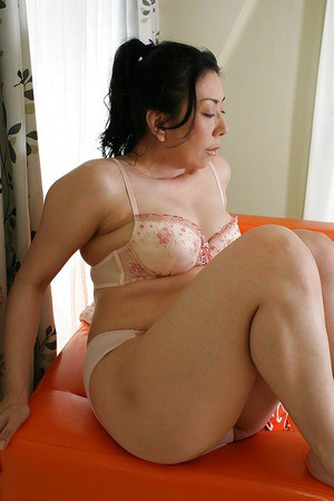 Saucy asian MILF Kumiko Yasue poses in lingerie and reveals her shapely tits