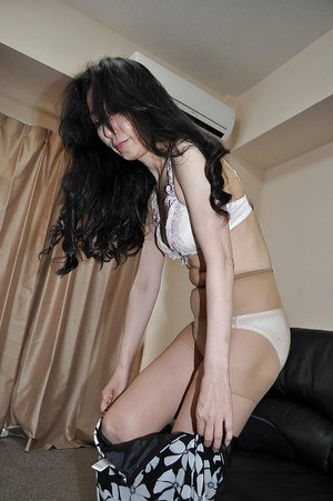 Asian mature lassie Nobue Toyoshima stripping and teasing her hairy twat