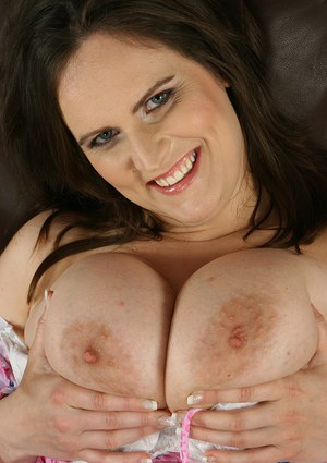 Playful european MILF oils up her huge melons and inviting cunt