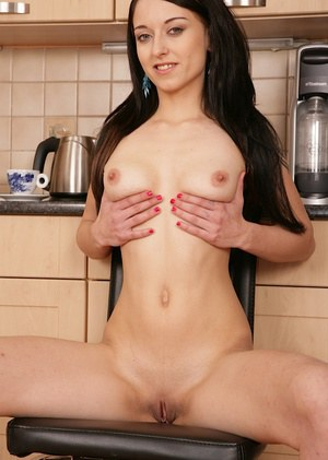 Well-graced amateur undressing and fingering her cunt in the kitchen