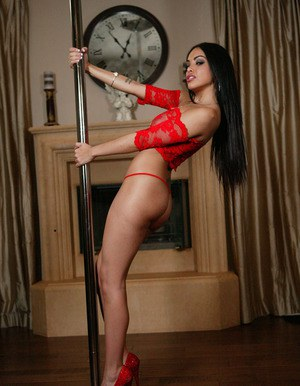 Wooing latina vixen in provocative red outfit performs a striptease