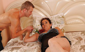 Sex-hungry mom with saggy tits gets fucked and facialized by a younger boy