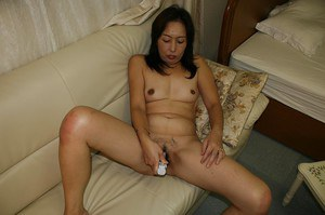 Lewd asian granny Masae Funakoshi stripping and playing with sex toys