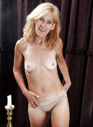 Lewd mature blonde undressing and teasing her cunt with her fingers