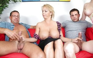Juggy mature blonde strokes two swollen cocks while her friend watching