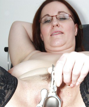 Fatty mature gal with big saggy jugs gets her twat examed by naughty gyno