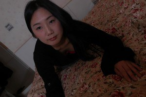 Naughty asian MILF Tomomi Sawamura undressing and playing with her sex toys