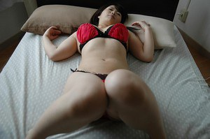 Frisky asian lady undressing and exposing her juicy cunt in close up