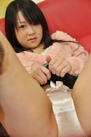 Asian teen Syoko Narita takes off her panties and has some sex toys fun