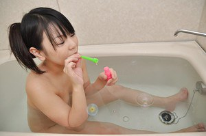 Playful asian teenage cutie Syoko Narita has some fun in the bath
