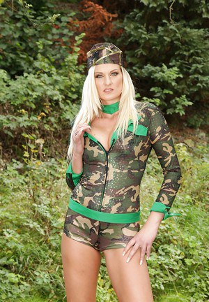 Seductive blonde in military outfit getting naked and exposing her pussy