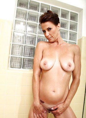 Lusty mature lady has some wet pussy masturbating fun in the shower