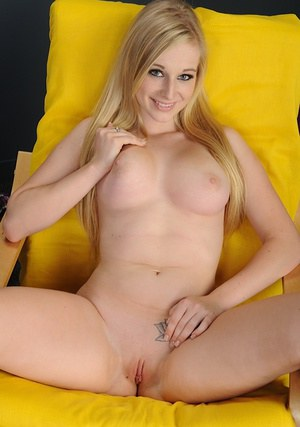 Sweet babe with shaved cunt Avril Vagine undressing and spreading her legs