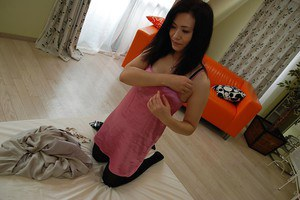 Cuddly asian MILF Chisato Miura strips down and gets teased with vibrator