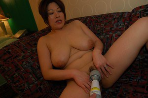 Chubby asian MILF Hiromi Yoshio gets naked and enjoys pussy toying action