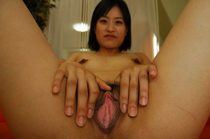 Frisky asian MILF Misuzu Okazaki undressing and spreading her pussy lips