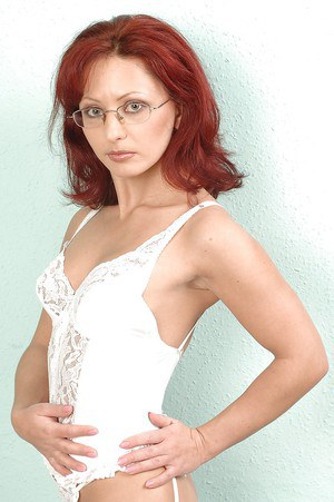 Redhead MILF in glasses Liza Minell playing with her sex toys