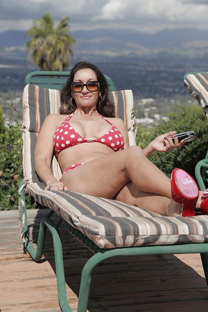 Sassy MILF in sunglasses revealing her jugs and pussy outdoor