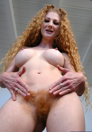 Curly-haired MILF Annie Body undressing and exposing her hairy cunt
