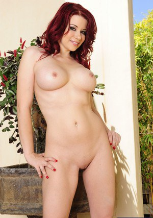 Redhead doxy Sarah Blake taking off her bikini and fingering her shaved gash