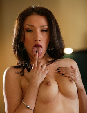 Playful asian vixen undressing and showcasing her graceful curves