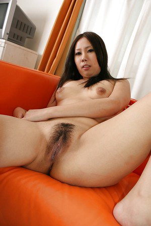 Chubby asian chick Eiko Arita undressing and spreading her legs