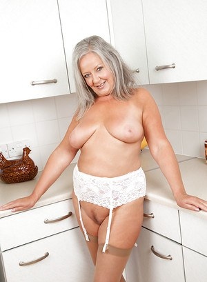 Naughty granny with chubby curves undressing and playing with herself
