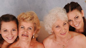 Dirty-minded teenage lesbians perform foursome posing scene with lewd grannies
