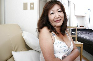 Asian granny Michiko Okawa undressing and exposing her hairy twat in close up