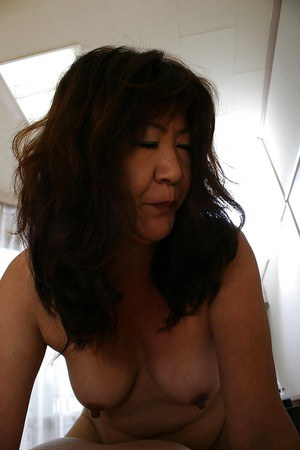 Asian granny Michiko Okawa gives a sensual blowjob and gets fucked