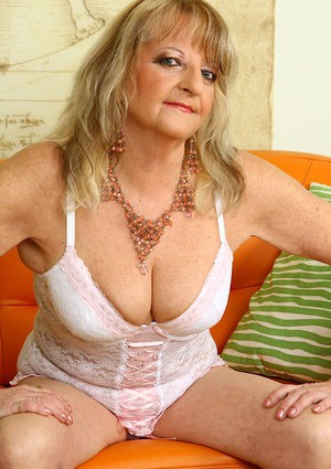 Lecherous mature blonde with saggy tits taking off her white lingerie