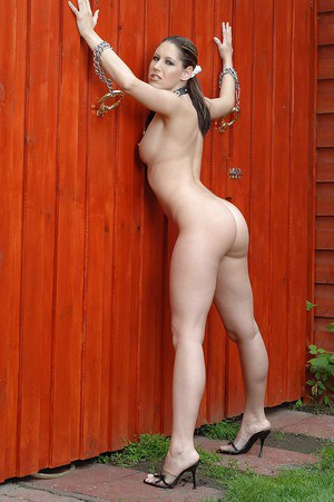 Playful MILF with shapely tits performs a fetish posing scene outdoor