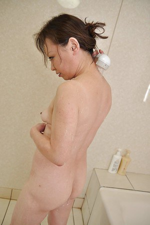 Asian mature slut Akemi Seo takes shower and gets cocked up