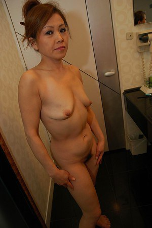 Asian MILF with saggy tits taking bath and teasing her hairy slit