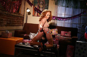 Petite redhead babe in nylon stockings performs a steamy striping scene