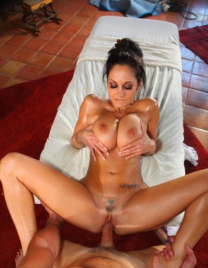 Deep-bosomed MILF gets oiled up and shagged tough on the massage table