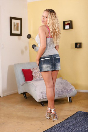 Pretty teenage blonde Britney Young uncovering her tempting curves