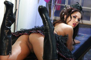 Steamy MILF in high-heeled boots Zoe Britton uncovering her curvaceous body