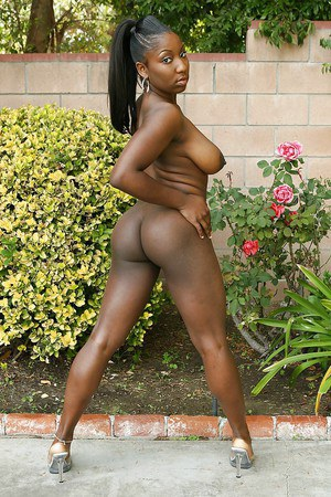 Curvaceous ebony lassie Ms Sassi demonstrating her goods outdoor