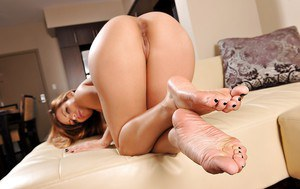 Busty latina Yurizan Beltran undressing and exposing her sexy bare feet