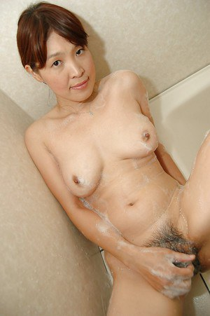 Asian MILF Takako Yanase taking shower and exposing her shaggy cunt