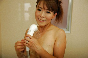 Asian MILF Kayo Mukai taking shower and exposing her shaggy cunt in close up