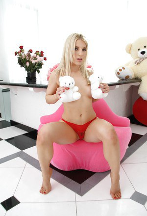 Playful topless blonde babe revealing her fanny and love holes