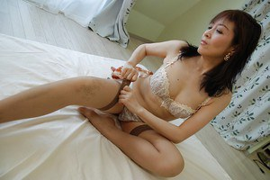 Asian MILF Shinobu Yabe undressing and exposing her cunt in close up