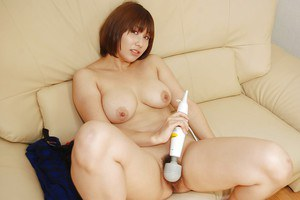 Naughty asian chick Tomoko Ochiai exposing and vibing her hairy cooter