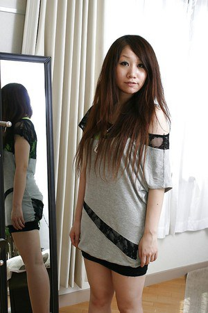 Shy asian babe Rie Noguchi slowly uncovering her tempting curves