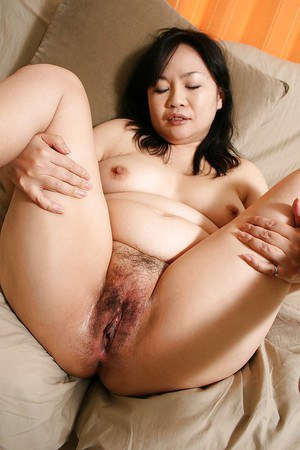 Sassy asian MILF Rumiko Shiga gets naked and has some pussy toying fun