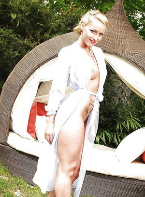 Wooing blonde with no lingerie under her nightgown posing and smoking