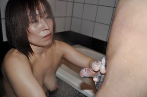 Asian MILF Yumi Ohno has some cock sucking and fucking fun in the bathroom