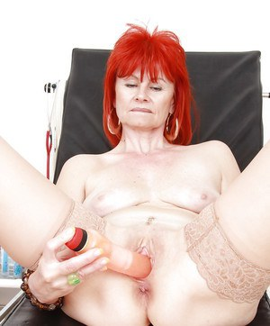 Redhead mature gal in stockings gets examed by a perverted gyno